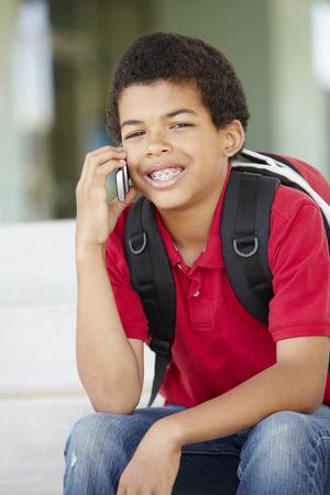 pre teen boy: Pre teen boy with phone at school