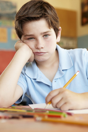 miserable: Unhappy boy in art class