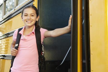 pre teen: Pre teen girl getting on school bus