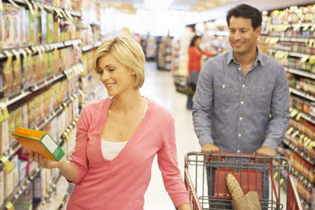 Couple shopping in supermarket photo