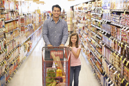 wheeling: Father and daughter shopping in supermarket