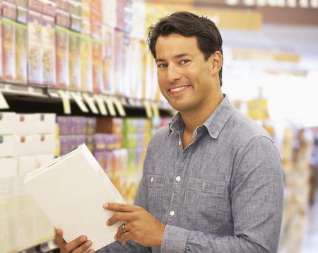 Man shopping in supermarket Stock Photo