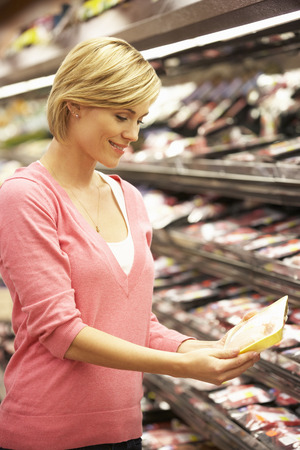 packaged: Woman shopping in supermarket Stock Photo
