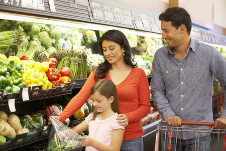 healthy choices: Family shopping in supermarket