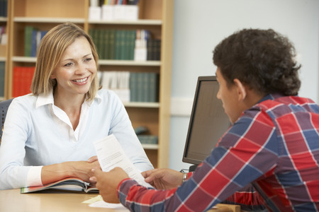 College tutor with student Stock Photo
