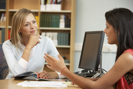 College tutor with student Stockfoto
