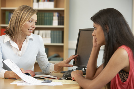 coursework: College tutor with student Stock Photo