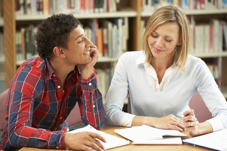 inappropriate: College tutor with student Stock Photo