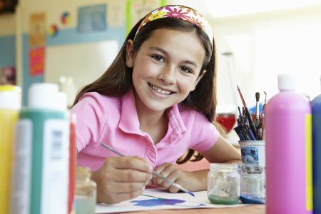informal clothing: Pre teen girl in art class Stock Photo