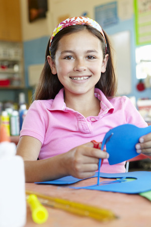 pre teen girl: Pre teen girl in art and craft class Stock Photo