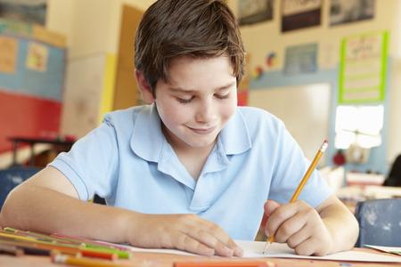 pre teen boy: Pre teen boy in art class Stock Photo