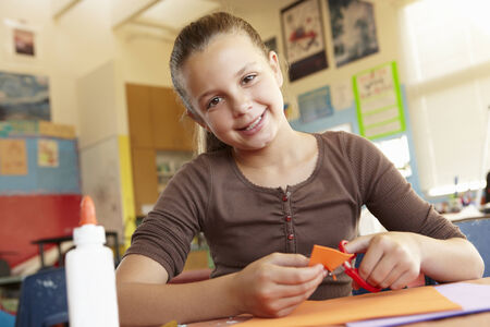 pre teen girls: Pre teen girl in art and craft class Stock Photo