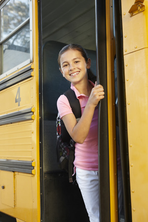 pre school: Pre teen girl getting on school bus