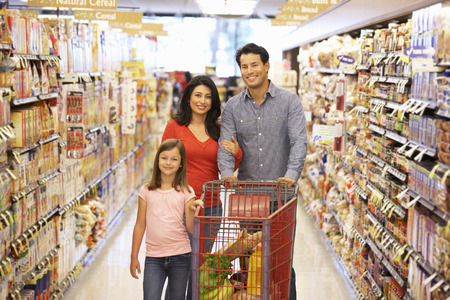 three shelves: Family shopping in supermarket
