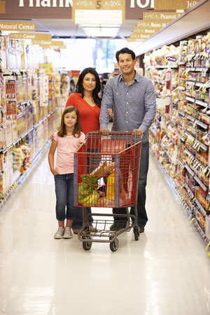 Family shopping in supermarket photo