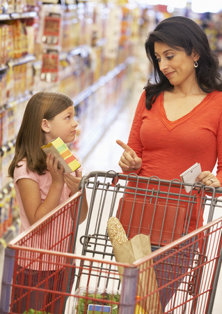 shopping trip: Mother and daughter shopping in supermarket