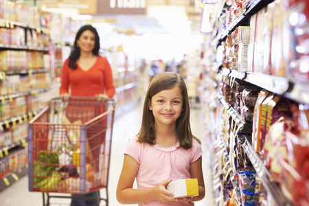 wheeling: Mother and daughter shopping in supermarket