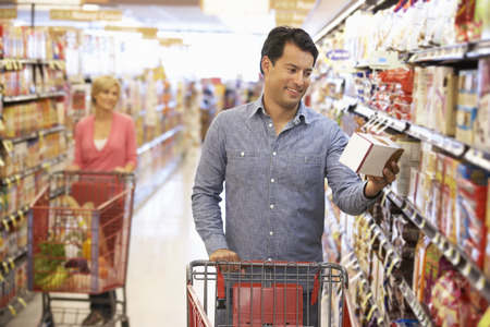 deciding: People shopping in supermarket