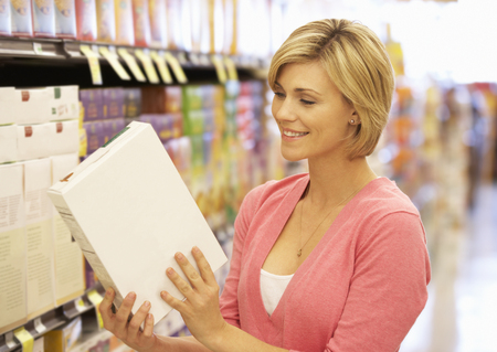 nutritional: Woman shopping in supermarket Stock Photo