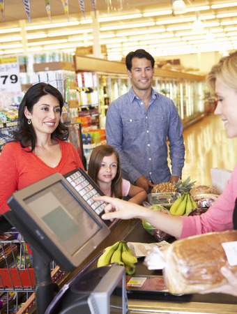 checkout: People at supermarket checkout