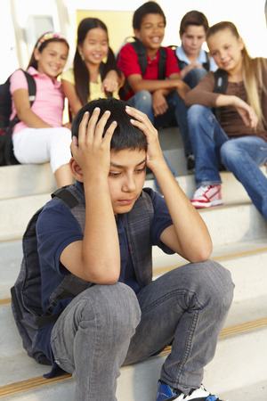 bullied: Boy being bullied in school