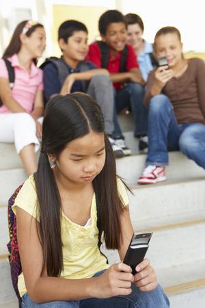 bullied: Girl being bullied in school
