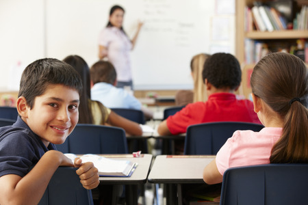 Teacher and schoolchildren in class photo