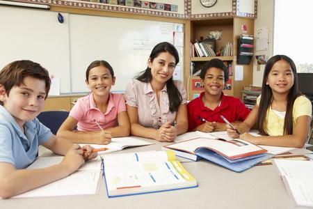 asian teacher: Teacher and schoolchildren in class