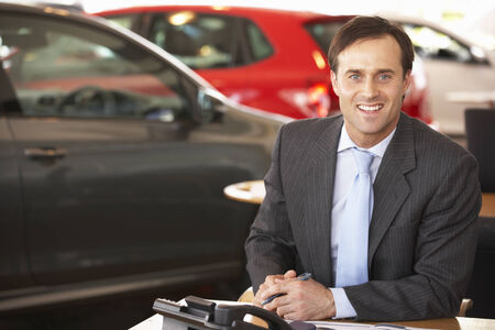 serve one person: Man working in car showroom