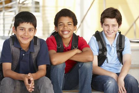 学校で事前に十代の少年たち 写真素材