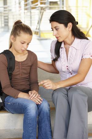 pre adult: Unhappy Pre teen girl in school