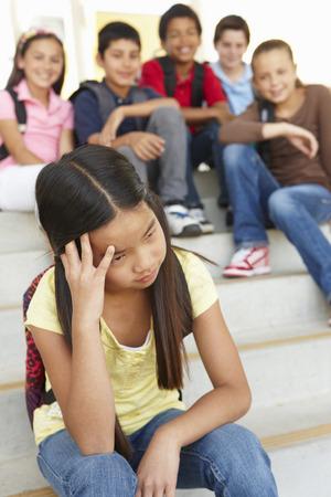 Girl being bullied in school photo