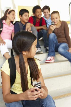 being: Girl being bullied in school