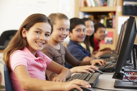 5 year old girl: Schoolchildren working on computers