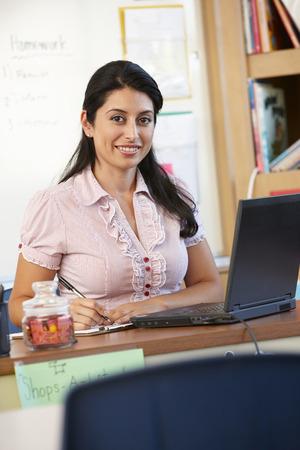 informal clothing: Teacher in classroom