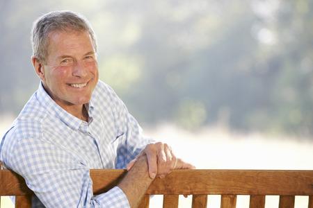 youthful: Senior man sitting outdoors