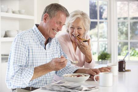 Retired couple eating breakfast photo