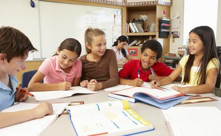 collaborating: Teacher and schoolchildren in class