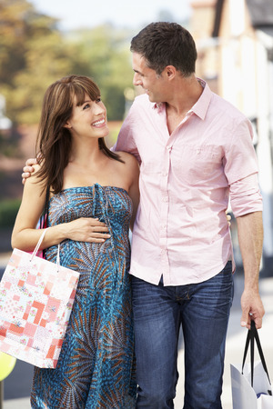 baby bump: Expectant couple out shopping Stock Photo