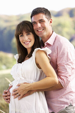 anticipating: Expectant couple outdoors in countryside
