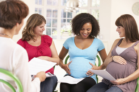 Pregnant women at ante natal class Standard-Bild