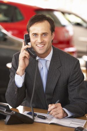 sales call: Man working in car showroom