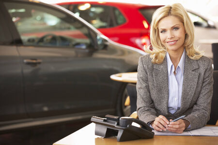 serve one person: Woman working in car showroom Stock Photo
