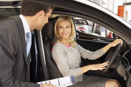 buying: Woman buying new car