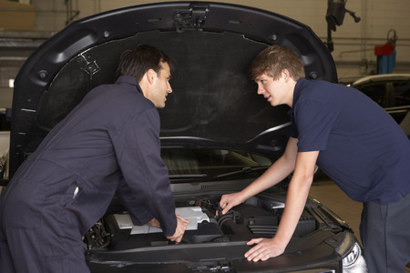 Trainee mechanic at work photo