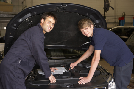 two car garage: Trainee mechanic at work