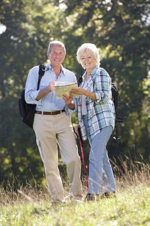 Senior couple on country walk photo
