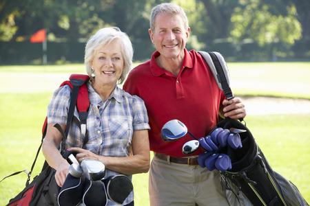 Senior couple on golf course 스톡 콘텐츠