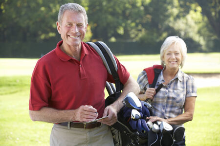 Senior couple on golf course photo