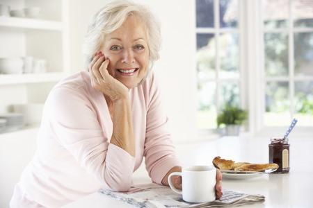 leisurely: Retired woman eating breakfast